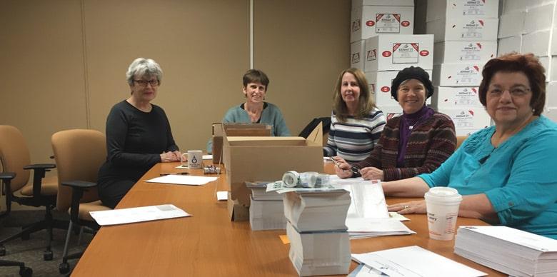 Volunteers working with Ann Marie