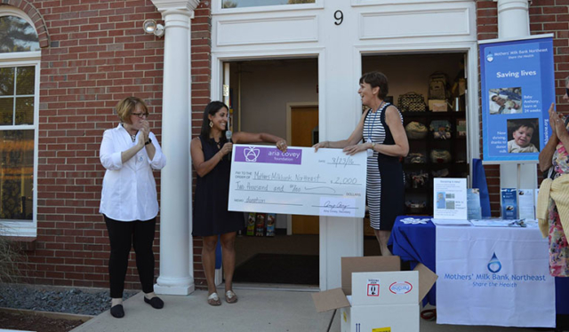 Nini Bambini - First New Hampshire milk depot celebration - Generous check from Aria Covey