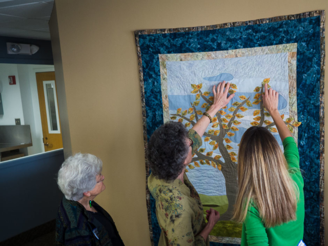 Looking at the beautiful quilt