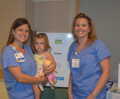 Milk donor Janelle Black, RN and Emily Nichols
